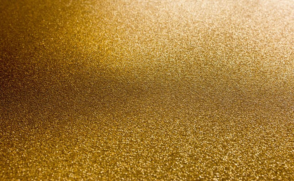 Close-up von einer Druckveredelung mit Gold.