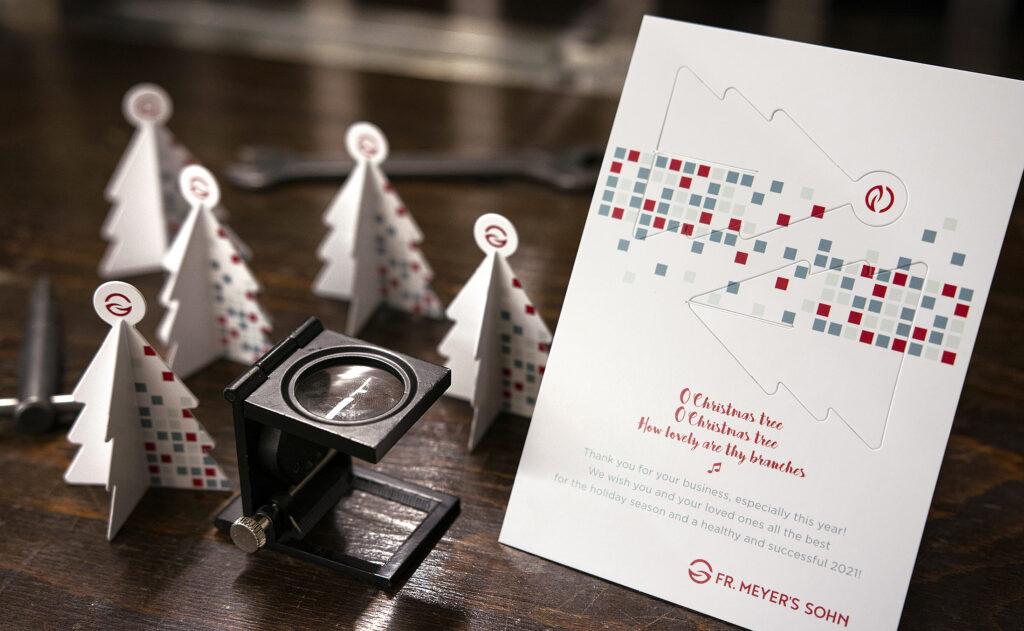 Kreative Weihnachtskarten mit einer originellen Stanzung für Fr. Meyer's Sohn.