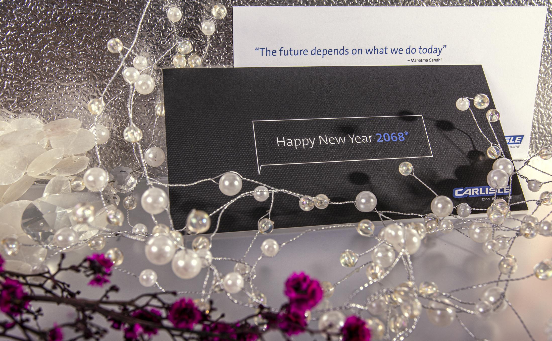 Neujahrskarte im Letterpress und Offsetdruck mit drei Pantonefarben und einer Hochprägung