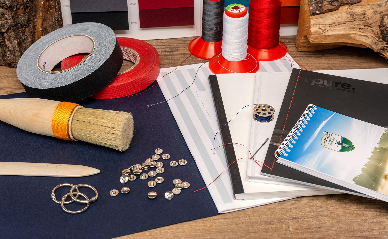 Druckweiterverarbeitung und Buchbinderei in Hamburg mit verschiedenen Bindetechniken auf einen Blick